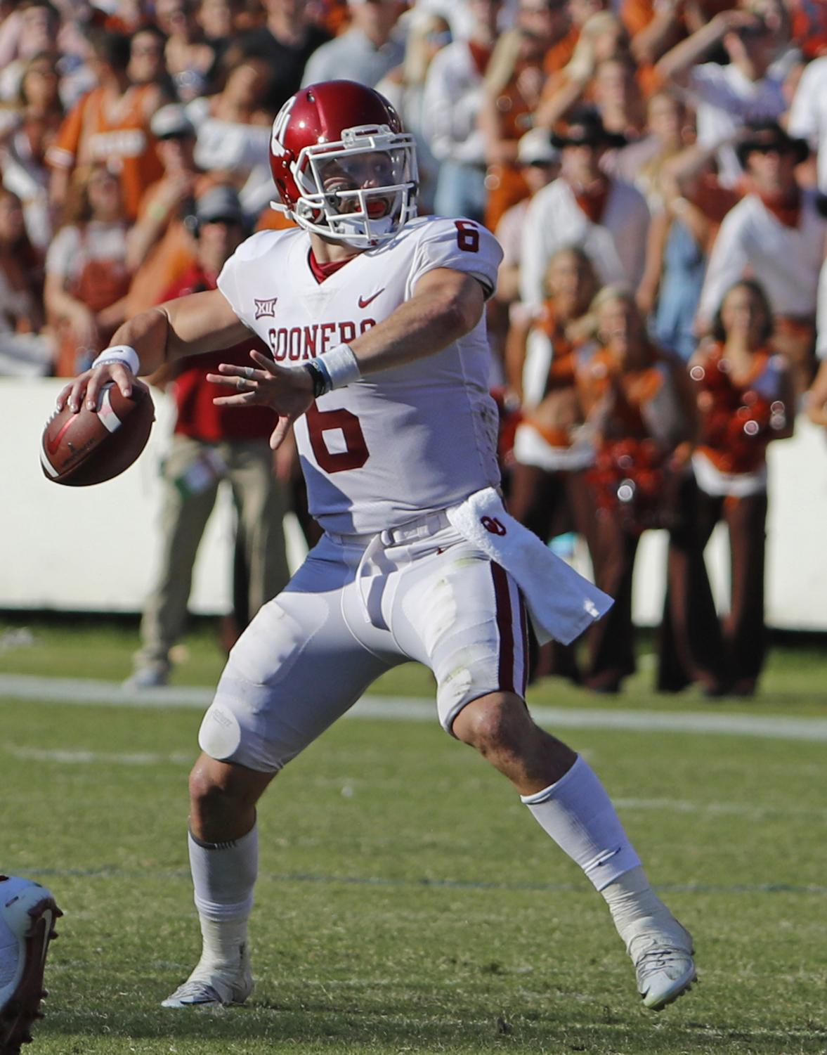 Baker Mayfield steps into a pass against Texas in the Red River Rivalry.