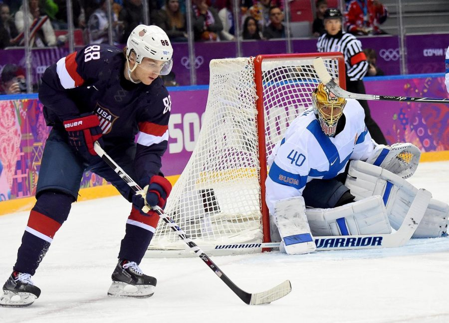 NHL+players+Patrick+Kane+and+Tukka+Rask+in+the+2014+Bronze+medal+game.