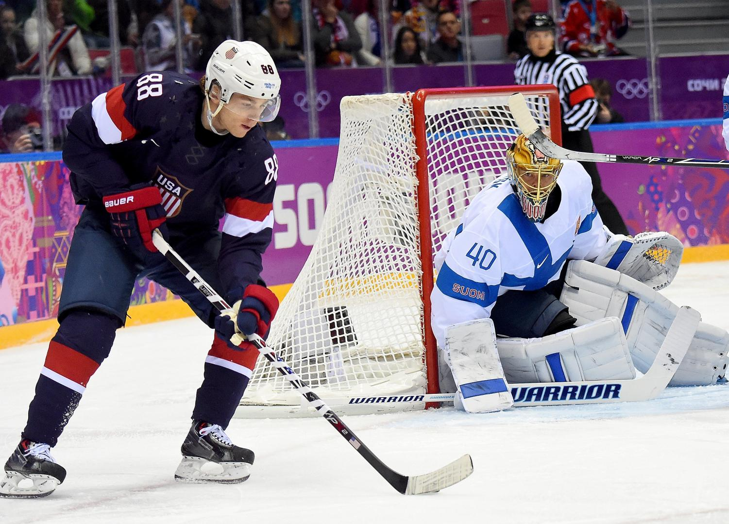 NHL players Patrick Kane and Tukka Rask in the 2014 Bronze medal game.