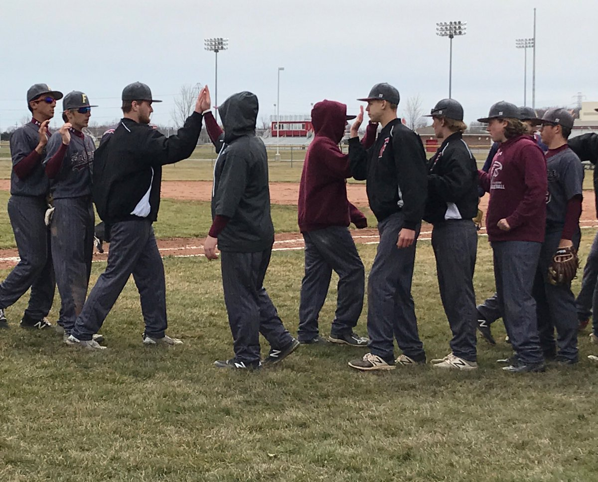 The Varsity Baseball team celebrating their win on Saturday against Anchor Bay.