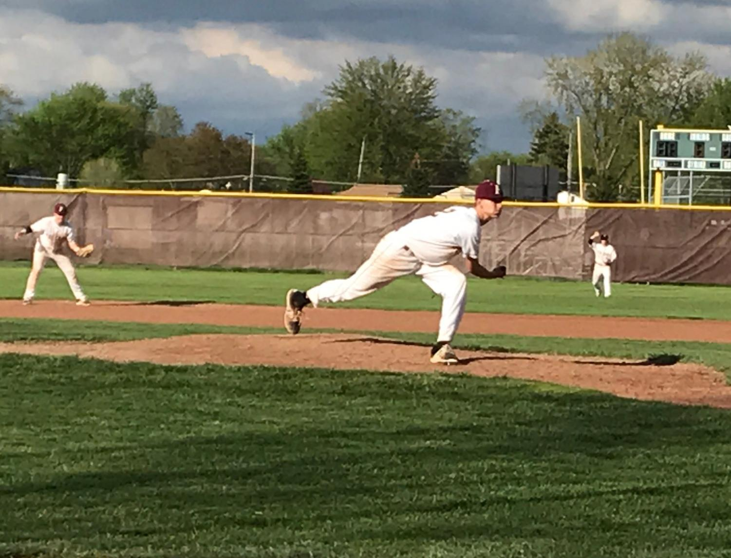 Junior pitcher Nolan Hood takes stride to finish his pitch.