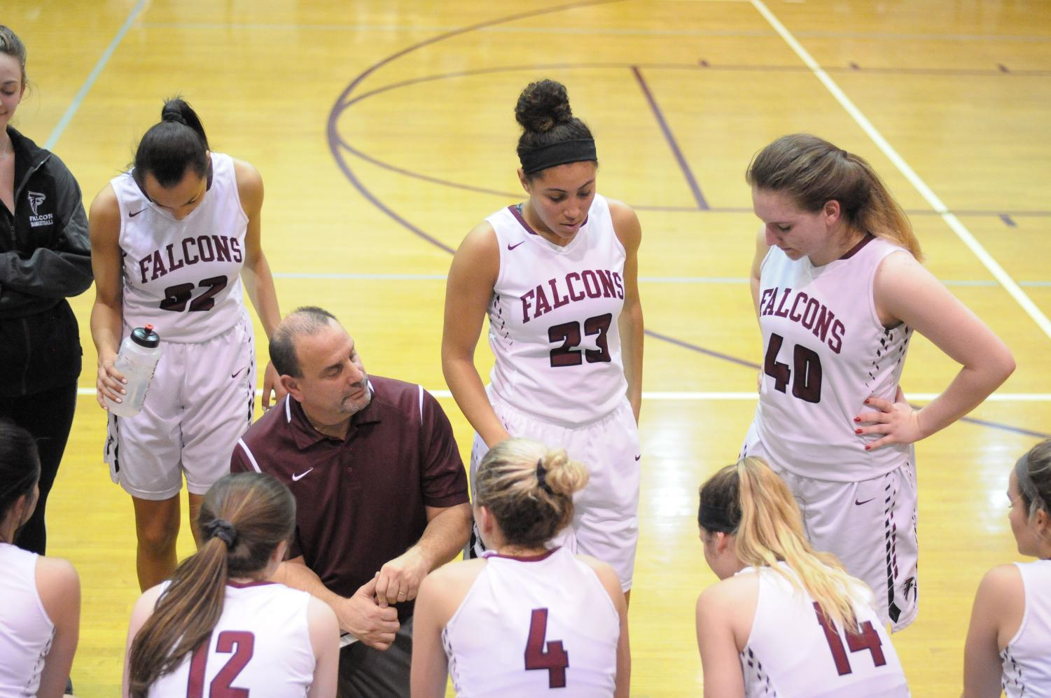 Head Varsity Girls Basketball coach Matt Joseph critiques his team's gameplay during a timeout during the 2017-2018 season.
