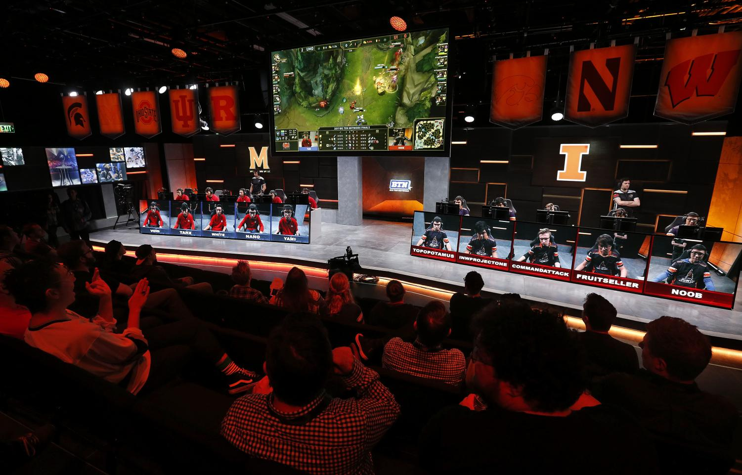 The audience watches a match between the University of Maryland, left, and the University of Illinois in the Big Ten Network